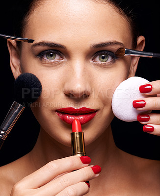 Buy stock photo A beautiful young woman having various make up techniques tried on her face