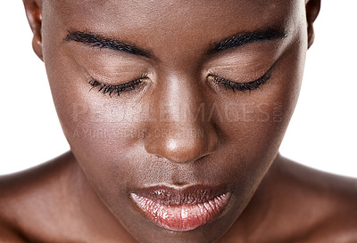 Buy stock photo Closeup studio shot of a beautiful young african woman with her eyes closed isolated on white