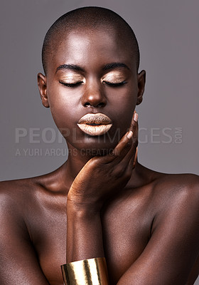 Buy stock photo A beautiful african woman standing in a studio with her eyes closed