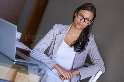 Buy stock photo Portrait of an attractive young businesswoman sitting at her office desk