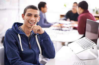 Buy stock photo Cropped shot of a handsome young man working on his laptop in an office
