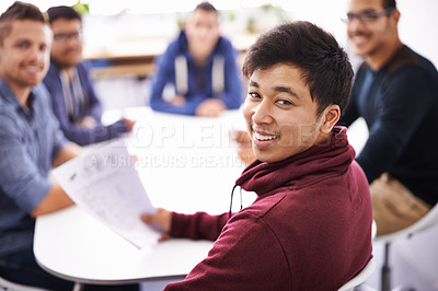 Buy stock photo Shot of a group of guys having a meeting