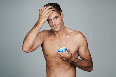 Buy stock photo Cropped portrait of a handsome mature man styling his hair with gel