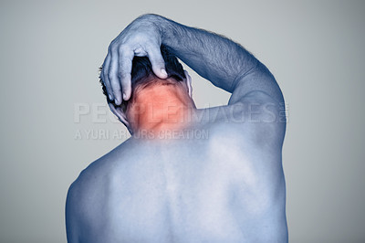 Buy stock photo Rear view shot of a mature man with neck pain that's highlighted in red
