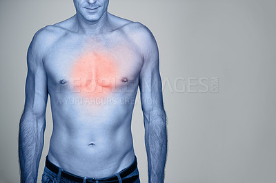 Buy stock photo Studio shot of a mature man with chest pain highlighted in red