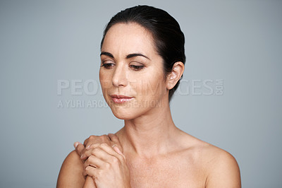 Buy stock photo Cropped shot of a beautiful mature woman in the studio