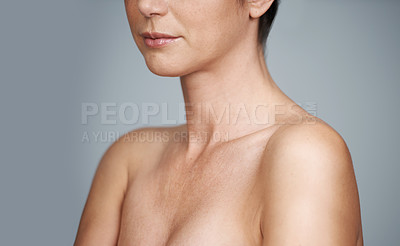 Buy stock photo A head and shoulders cropped view of a beautiful mature woman isolated on grey