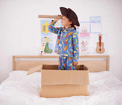 Buy stock photo A little boy playing pirate in a cardboard box