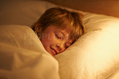 Buy stock photo Shot of a little boy asleep in his bed