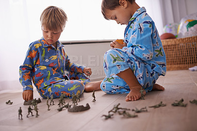 Buy stock photo Shot of two little boys playing on their bedroom floor