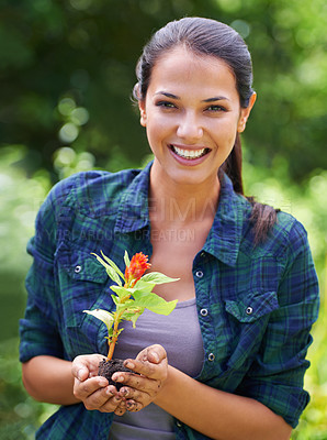 Buy stock photo Portrait of an attractive young woman holding a young plant