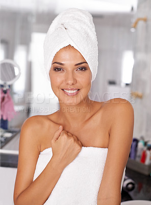 Buy stock photo Portrait of a beautiful young woman standing in the bathroom in a towel