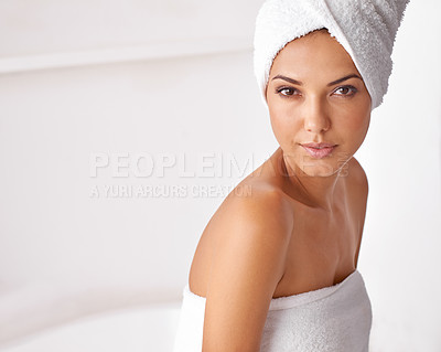 Buy stock photo Portrait of a beautiful young woman wrapped in a towel