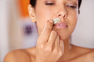 Buy stock photo Shot of a woman waxing her upper lip