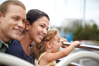 Buy stock photo A young family seeing the city on the top of a bus