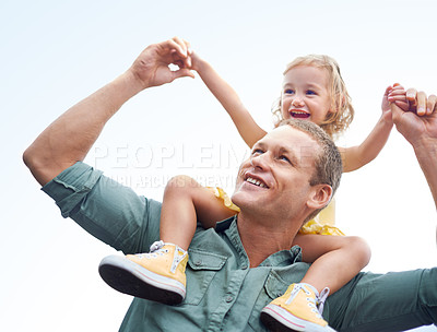 Buy stock photo Shot of a father lifting his little girl above his head