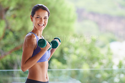 Buy stock photo A portrait of a beautiful young woman lifting dumbbells outdoors