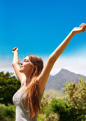 Buy stock photo A young woman enjoying the sunshine