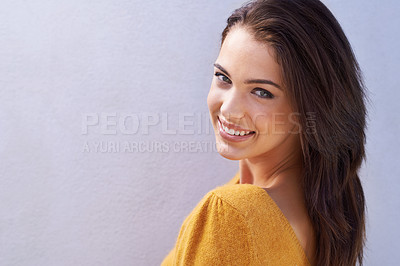 Buy stock photo Portrait of a beautiful young woman looking over her shoulder