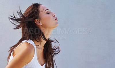 Buy stock photo Shot of a beautiful young woman flinging her brunette hair