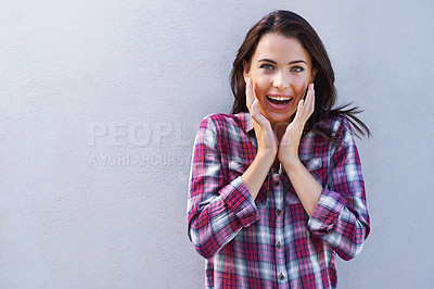 Buy stock photo Shot of an attractive young brunette woman standing against a gray background