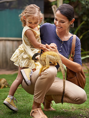 Buy stock photo Shot of a young mother and her daughter at a monkey sanctuary