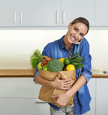 Buy stock photo A young woman with vegetables in the kitchen