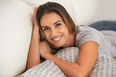 Buy stock photo Portrait of a woman lying down on her sofa