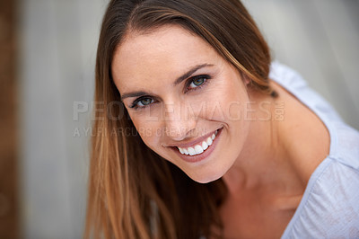Buy stock photo Portait of a young woman sitting outdoors