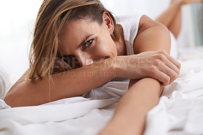 Buy stock photo Portrait of a beautiful young woman lying in her bed