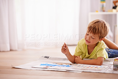 Buy stock photo Shot of a cute little boy painting a picture at home