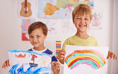 Buy stock photo Shot of two young boys painting at home