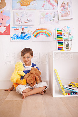 Buy stock photo Portrait of a cute little boy playing with his stuffed animals in his room
