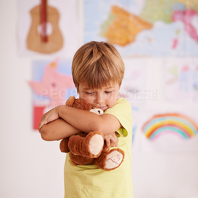 Buy stock photo Shot of a cute little boy hugging his teddybear