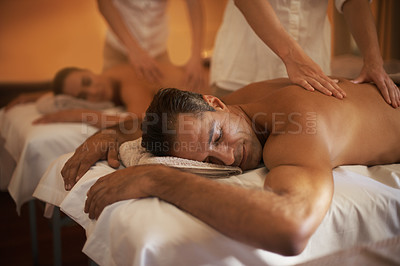 Buy stock photo Shot of a mature couple enjoying a relaxing massage