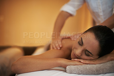 Buy stock photo Shot of an attractive woman enjoying a relaxing massage