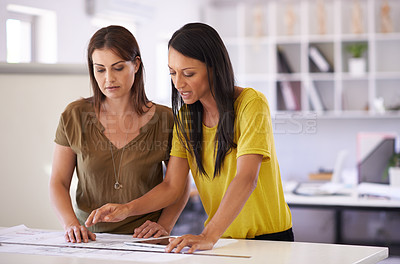 Buy stock photo Shot of two seamstresses at work