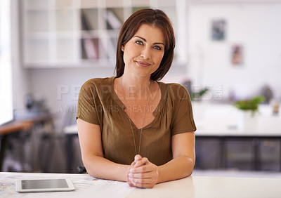 Buy stock photo Portrait of a young brunette woman sitting at her desk