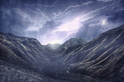 Buy stock photo Shot of a dramatic thunderstorm over a mountain