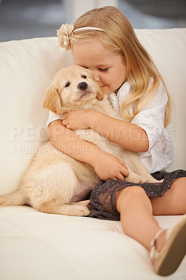 Buy stock photo Cropped shot of a little girl holding a puppy