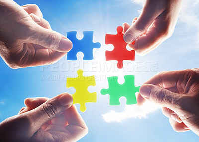 Buy stock photo Cropped shot of hands holding four puzzle pieces