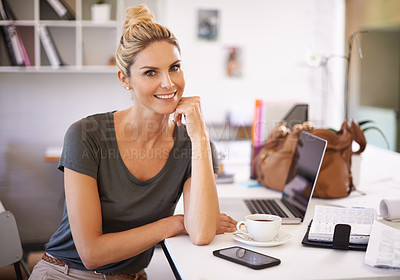 Buy stock photo A confident young businesswoman sitting at her desk