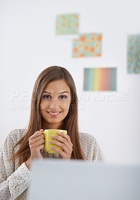 Buy stock photo Portrait of a young woman sitting in the office with a cup of coffee