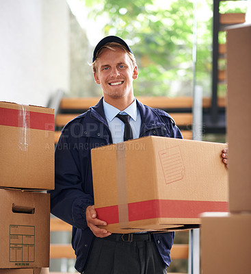 Buy stock photo Shot of a happy courier holding a box