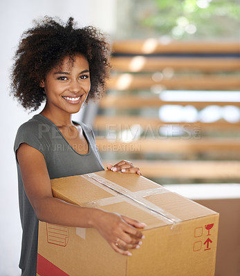 Buy stock photo Shot of a young woman moving into her new house