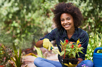 Buy stock photo Portrait of a happy young woman and her tray of plants for the garden