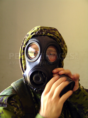 Buy stock photo Man fixing his gas mask