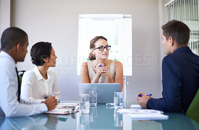 Buy stock photo A group of businesspeople listening to their colleague during a meeting