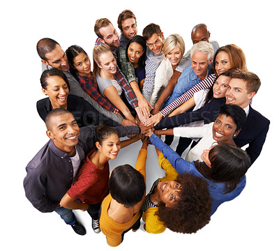 Buy stock photo Shot of a diverse group of business people joining their hands in a symbol of unity