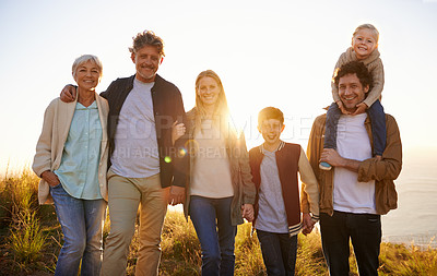 Buy stock photo Shot of a happy family out on a morning walk together